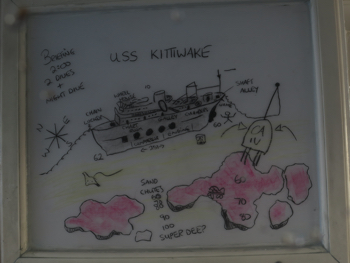 The dive briefing board for the Kittiwake dive off of the Cayman Aggressor